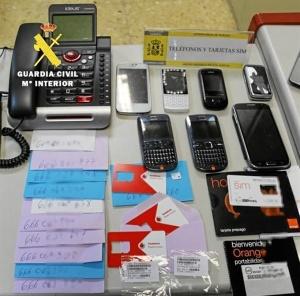 Teléfonos y tarjetas sim incautadas